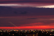 Red sky at sunset as an aircraft departs Miami International Airport. WATERMARKS WILL NOT APPEAR ON PRINTS OR LICENSED IMAGES.