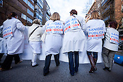 Back view of health care staff wearing placards,Madrid.
