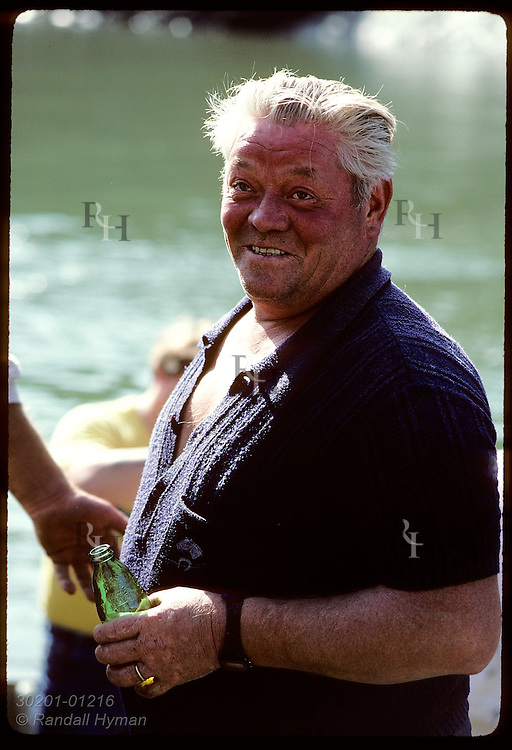 Portrait of man in town of Le Bono involved in annual clam harvest; Morbihan, Britttany. France
