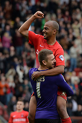 Leyton Orient's Jamie Jones and Leyton Orient's Elliot Omozusi  celebrate Orient's victory - Photo mandatory by-line: Mitchell Gunn/JMP - Tel: Mobile: 07966 386802 12/10/2013 - SPORT - FOOTBALL - Brisbane Road - Leyton - Leyton Orient V MK Dons - League One