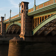 London's Southwark Bridge catches the golden rays of late afternoon.