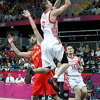 04 August 2012: Russia Vitaliy Fridzon goes for the layup past Spain Juan-Carlos Navarro during 77-74 Team Russia victory over Team Spain, during the men's basketball preliminary, at the Basketball Arena, in London, Great Britain.