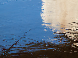 The water freezes and thaws on Lake Nokomis in early winter forming interesting abstract landscapes