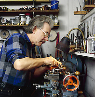 craftsman making Northumbrian Pipes on a lathe in his workshop