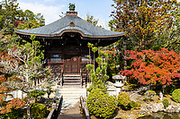 Seiryo-ji, is also known as Saga Shakado - one of the main temples in the Arashiyama district of Kyoto. Its main hall was built in 945 by order of the imperial princess.  After many wars, fires and reconstructions, the present main hall was built in 1701. Seiryo-ji is home to two gardens that can be accessed from its main hall.  After visiting the main hall itself, a bridge hovers at the back of the building. In the corner of the bridge there is a pond garden with a stone lantern and a pagoda within, composed in a Pure Land style.