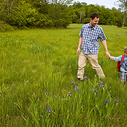 A young boy (age 4) and his father explore a field at Highland Farm in York, Maine.