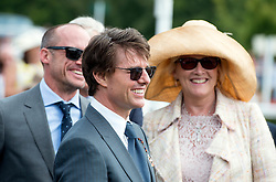 © Licensed to London News Pictures. 31/07/2014. Chichester, UK Hollywood actor Tom Cruise arrives to present a Trophy.  Ladies Day at Glorious Goodwood at Goodwood racecourse in Chichester today 31/07/14. Photo credit : Stephen Simpson/LNP