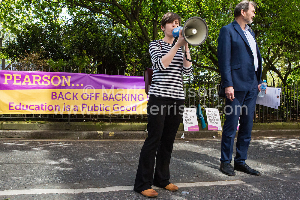 London, UK. 4th May, 2018. Amy Hunt of the National Education Union (NUT Section) addresses members  demonstrating outside the AGM of multinational assessment service Pearson in protest against investment by the corporation in 'low-fee' private schools provider Bridge. Bridge, one of the world's largest education-for-profit companies, aims to extend its influence throughout Africa and Asia.