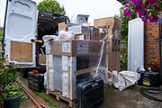 All the equipment required to install an Air source heat pump arrives at a house in Folkestone, United Kingdom on the 20th of September 2021.  Solaris Energy arrive at a customer in Folestone with the air source heat pump, new hot water tank, a buffer, new radiators and all the required equipment to install and air source heat pump. With gas prices increasing and the increasing need to reduce fossil fuel air source heat pumps are slowly starting to replace the gas boiler use in properties in the UK.