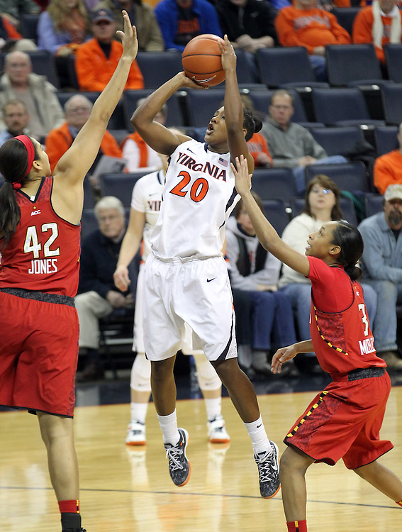 Virginia guard Faith Randolph (20) shoots between Maryland center Brionna Jones (42) and Maryland guard Brene Moseley (3) during the game Thursday in Charlottesville, VA. Virginia defeated Maryland 86-72. Photo/The Daily Progress/Andrew Shurtleff