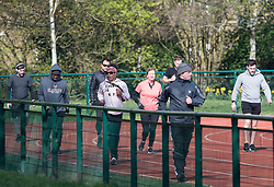 © Licensed to London News Pictures. 28/03/2020. London, UK. Early morning joggers at Paddington Recreation Ground in London, during a lockdown over the spread of COVID-19. Prime Minister Boris Johnson has announced that people should only leave their homes for essential work, groceries, medical necessity and exercise. Photo credit: Ben Cawthra/LNP
