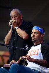 27 April 2013. New Orleans, Louisiana,  USA. .New Orleans Jazz and Heritage Festival. Ben Harper (foreground) is joined by Charlie Musselwhite on the Gentilly stage..Photo; Charlie Varley.