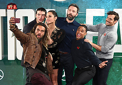 Jason Momoa, Ezra Miller, Gal Gadot, Ben Affleck, Ray Fisher and Henry Cavill attending the Justice League Photocall at The College, London. Picture credit should read: Doug Peters/Empics Entertainment