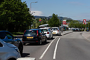 MERTHYR TYDFIL, WALES - 07 MAY 2020 - Cars queue for a long awaited KFC after 6 weeks of closers due to the covid19 epidemic.