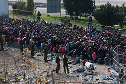 Licensed to London News Pictures. 31/10/2015. Sentilj, Slovenia. Migrants are beeing escorted to the Austrian border in Sentilj at a border crossing between Slovenia and Austria. Photo: Marko Vanovsek/LNP
