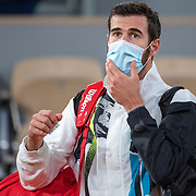 PARIS, FRANCE October 05. Karen Khachanov of Russia  leaves the court wearing a mask after his loss against Novak Djokovic of Serbia in the fourth round of the singles competition on Court Philippe-Chatrier during the French Open Tennis Tournament at Roland Garros on October 5th 2020 in Paris, France. (Photo by Tim Clayton/Corbis via Getty Images)