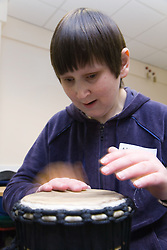 Visually impaired woman playing the drum during a drumming workshop at the NRSB activity day at their centre on Ortzen Street,  This is part of the IMPACT project; an interactive road show delivering a series of events designed to give the visionimpaired community of Nottinghamshire the opportunity to IMPACT on the future of Notts Royal Society for the Blind,