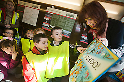 "The Children of Ryecroft school Rawmarsh celebrate World Book Day at Parkgate Shopping Rotherham listening to childrens author Michaela Morgan reading her book ""Never Shake A Rattle Snake"" on the top deck of one of the Yorkshire Transports Museums buses which was parked outside W.H. Smiths espcially for the occasion...http://www.pauldaviddrabble.co.uk..1 March 2012 -  Image © Paul David Drabble"
