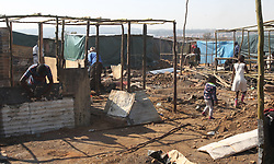 South Africa - Pretoria - 21 July 2020 - Residents of Plastic View informa settlement are rebuilding their homes after Saturday's fire.<br />Photo: Jacques Naude/African News Agency(ANA)