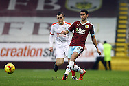 George Boyd of Burnley passes the ball under pressure from Harry Bunn of Huddersfield town. Skybet football league Championship match, Burnley v Huddersfield Town at Turf Moor in Burnley ,Lancs on Saturday 31st October 2015.<br /> pic by Chris Stading, Andrew Orchard sports photography.