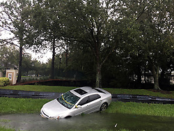 October 7, 2016 - Cocoa Beach, Florida, U.S. - A car rests in a ditch off 17/92 in the Longwood/Lake Mary area in front of the Wyndham Place apartments. Matthew lashes Florida With 100 MPH Winds, 1 Dead as 600,000 without power. (Credit Image: © Jacob Langston/TNS via ZUMA Wire)