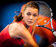 The 2013 Australian Open - a Grand Slam Tournament - is the opening event of the tennis calendar annually. The Open is held each January in Melbourne, Australia. Agnieszka Radwanska in play at the 2013 Australian Open - a Grand Slam Tournament - is the opening event of the tennis calendar annually. The Open is held each January in Melbourne, Australia.