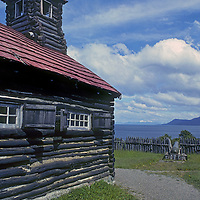 A cannon and reconstructed log church at Fort Bulnes, an early Chilean outpost built to guard the Strait of Magellan.