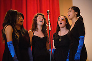 Members of the Milpitas High School Glee Club perform during the Milpitas Chamber of Commerce 21st Annual Auction & Crab Feed at Napredak Hall in San Jose, California, on March 7, 2014. (Stan Olszewski/SOSKIphoto)