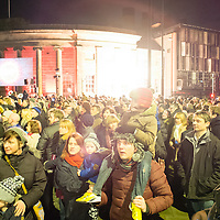 LIVERPOOL, UK, 1st March, 2014. People gather outside the Everyman Theatre to watch the finale of the opening celebrations.