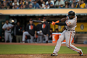 San Francisco Giants center fielder Denard Span (2) makes contact with a ball against the Oakland Athletics at Oakland Coliseum in Oakland, California, on July 31, 2017. (Stan Olszewski/Special to S.F. Examiner)