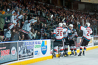 KELOWNA, CANADA - JANUARY 3: Cole Linaker #26, Justin Kirkland #23, Nick Merkley #10 and Devante Stephens #21 of Kelowna Rockets celebrate a goal against the Prince George Cougars on January 3, 2015 at Prospera Place in Kelowna, British Columbia, Canada.  (Photo by Marissa Baecker/Shoot the Breeze)  *** Local Caption *** Cole Linaker; Justin Kirkland; Nick Merkley; Devante Stephens;