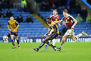 Tammy Abraham of Bristol City passes the ball while under pressure from James Tarkowski of Burnley. The Emirates FA cup 4th round match, Burnley v Bristol City at Turf Moor in Burnley, Lancs on Saturday 28th January 2017.<br /> pic by Chris Stading, Andrew Orchard Sports Photography.