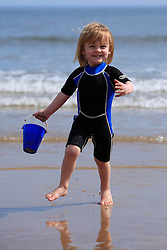 © Licensed to London News Pictures. 06/05/13 2 year old Khy Allott has some fun in the sun as people start to head to the beach in Tynemouth North East England to enjoy the bank holiday weather as a warm front sits over the country Photo credit : John Millard/LNP