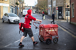December 17, 2018 - Glossop, Derbyshire, UK - Glossop, UK. A postman wearing a red Santa Claus Christmas sweater and shorts , delivers mail to homes and businesses in Glossop Town Centre  (Credit Image: © Joel Goodman/London News Pictures via ZUMA Wire)