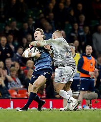 Cardiff Blues' Blaine Scully is tackled by Ospreys' Dimitri Arhip<br /> <br /> Photographer Simon King/Replay Images<br /> <br /> Guinness PRO14 Round 21 - Cardiff Blues v Ospreys - Saturday 28th April 2018 - Principality Stadium - Cardiff<br /> <br /> World Copyright © Replay Images . All rights reserved. info@replayimages.co.uk - http://replayimages.co.uk