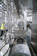 Decanter collection tanks are seen at the Puris pea protein processing facility in Dawson, Minnesota, on Tuesday, June 8, 2021.