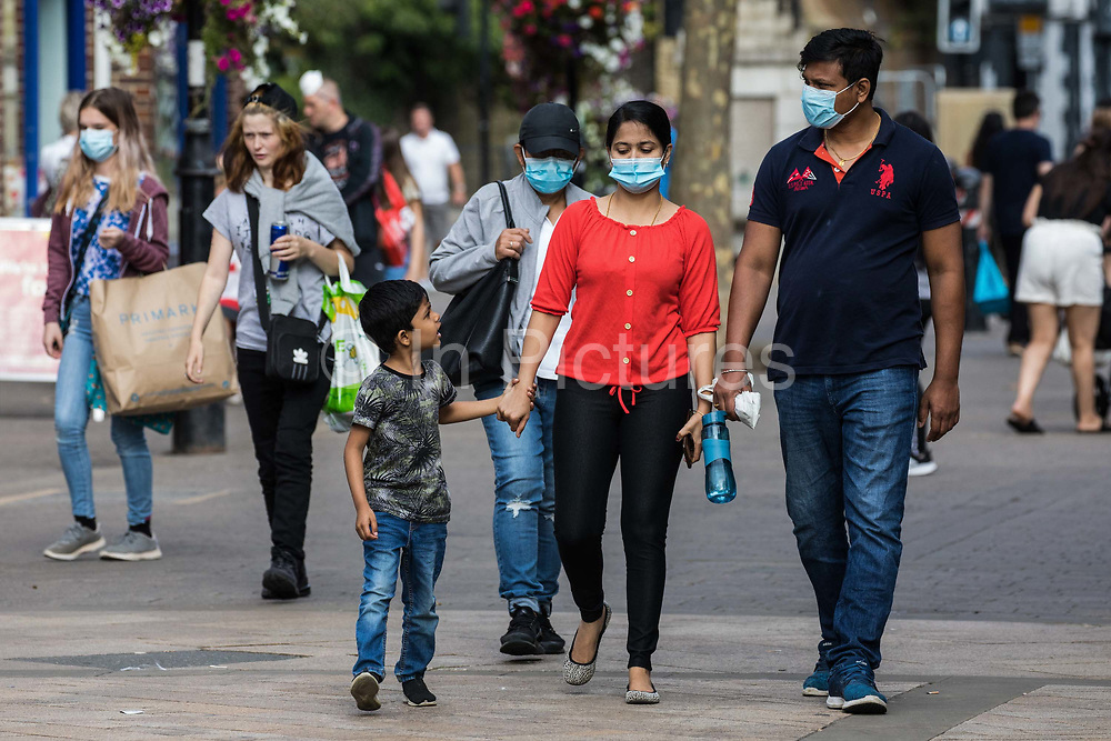 Shoppers wear face coverings to help prevent the spread of the coronavirus on 20 September 2020 in Staines-Upon-Thames, United Kingdom. The Borough of Spelthorne, of which Staines-upon-Thames forms part along with Ashford, Sunbury-upon-Thames, Stanwell, Shepperton and Laleham, has been declared an 'area of concern' for COVID-19 by the government following a marked rise in coronavirus infections which is inconsistent with other areas of Surrey.