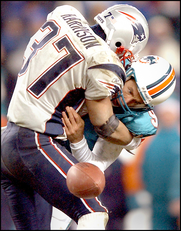 (12/7/03Foxboro, MA) New England Patriots vs Miami Dolphins. Jay Fiedler looks on helplessly as Rodney Harrison forces the fumble killing a deep third Q drive.  (120703patsmjs-staff photo by Michael Seamans. Saved in photo Monday/cd)