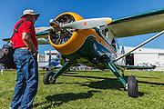 Visitor looking at De Havilland Beaver at 2014 Hood River Fly-In at WAAAM.
