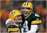 (2004)-Green Bay Packer quarterback Brett Favre celebrating a 16-yard touchdown pass to Donald Driver. This game was Favre's 200th regular season start.