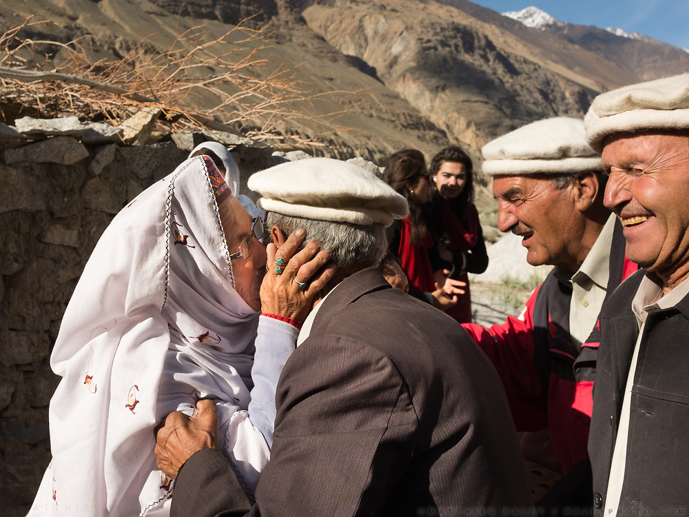 All women go to meet the groom family. Kissing them as they arrive. Zahir and Mariyam wedding celebration (love marriage), Zood Khun village, Chapursan valley.