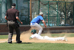 11 April 2015:  Brian Ekiss waits for a throw as Tim Coonan dives head first for 3rd base, Steve Jones covers the play during an NCAA division 3 College Conference of Illinois and Wisconsin (CCIW) Pay in Baseball game during the Conference Championship series between the Millikin Big Blue and the Illinois Wesleyan Titans at Jack Horenberger Stadium, Bloomington IL