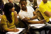 Tuition for students in Henry Thomas lecture theatre at London Metropolitan University's Holloway Road campus. Male and female students talk in the minutes before the lecture starts, seated on chairs with table surfaces attached. London Metropolitan University is one of the foremost providers of undergraduate, postgraduate, professional and vocational education and training in Britain. Their courses are planned in consultation with employers and examining bodies in commerce, industry, the world of art and design, the financial services industries and other professions. To compare profiles, Oxford University has the lowest proportion of working-class students, with 11.5%. London Metropolitan University has the greatest proportion, with 57.2%. The first building, designed by Charles Bell, was opened in 1896.