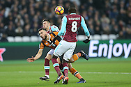 Robert Snodgrass of Hull City © is intercepted by Aaron Cresswell of West Ham United and Cheikhou Kouyate of West Ham United (r). Premier league match, West Ham Utd v Hull city at the London Stadium, Queen Elizabeth Olympic Park in London on Saturday 17th December 2016.<br /> pic by John Patrick Fletcher, Andrew Orchard sports photography.