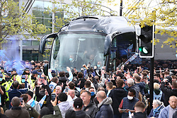 © Licensed to London News Pictures. 23/05/2021. Manchester, UK.  Man City fans go wild as the team bus, headed by manager Pep Guardiola arrives at the Etihad. Thousands of supporters have gathered at the Etihad Stadium to celebrate winning their 5th Premier League title in 10 years.  Photo credit: Adam Vaughan/LNP