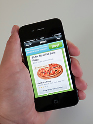 Using Groupon app to search for food  deals in New York City on iPhone 4G smart phone