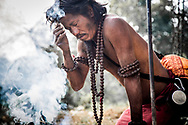 """Kathmandu, Nepal. This Sadhu, worshipper of lord Siva is bound to apply on his forehead the sacred ash also called """"Vibhuti"""".<br /> Photo by Lorenz Berna"""