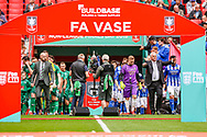 Chertsey Town Manager Dave Anderson and Cray Valley Manager Kevin Watson lead their teams out during the FA Vase final match between Chertsey Town and Cray Valley at Wembley Stadium, London, England on 19 May 2019.