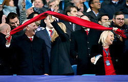 Former Liverpool player Ian Rush waves a red scarf to show his support during the match