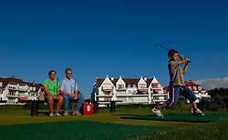 Reportage for Paris Match Belgium<br /> <br /> Frank and Carine Volders watch their son Jens Volders, 8 tee-off on the mini-golf course in Knokke-Zoute. The Volders live in Antwerp but have a family home in Knokke which they use for holidays. Knokke is Belgium's version of the Hamptons, an exclusive community on the North Sea, where the well-heeled come to play and be seen. (Photo © Jock Fistick)